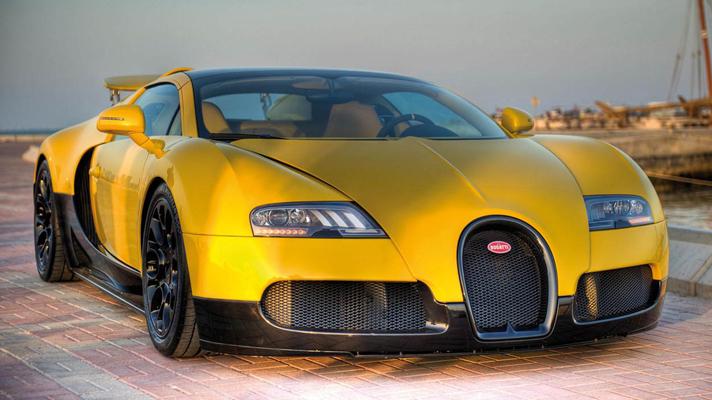 Yellow Veyron hits Qatar motor show   Top Gear